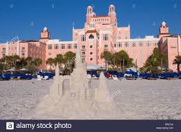 a sandcastle in front of the don cesar hotel under blue sky st