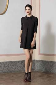 black short dress with sandals on bare legs bright makeup autumn