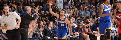 curry takes over as dubs down wizards golden state warriors