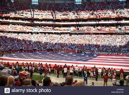 University Flags The American Flag At The University Of Phoenix Stadium During A