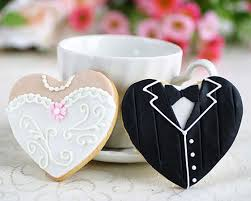 edible wedding favors heart shaped dress and tux cookies