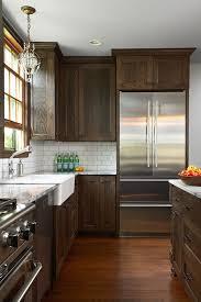 white backsplash dark cabinets fiddlehead design group kitchens dark stained cabinets white