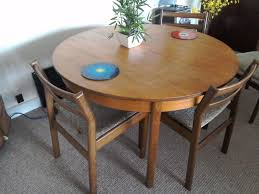 Round Dining Table Extends To Oval Vintage 70s Dining Table With Four Chairs Round But Extends To