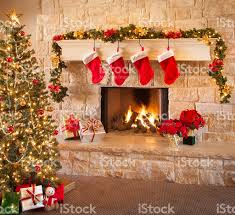 christmas stockings fire in fireplace tree and decorations stock