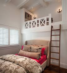 bed up high with wood paneling bedroom beach style and industrial