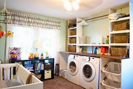 remodelaholic built in laundry unit with shelving built in laundry unit in bedroom nursery seesaws and sawhorses on remodelaholic