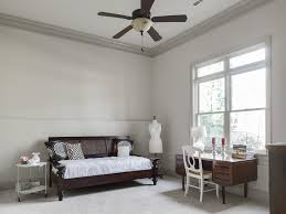 ceiling fan crown molding transitional guest bedroom with ceiling fan pb napoleon chair