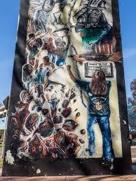 a visual pow at the san diego chicano park murals chicano park street art ningun ilegal