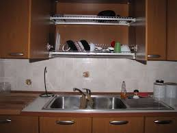 Install A Dish Drainer Above Your Sink Inside A Cupboard - Kitchen sink plate drainer