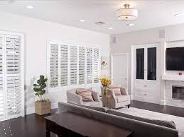white polywood shutters on white walls sunburst shutters