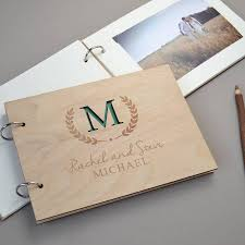 monogram guest book personalised monogram wedding guest book by clouds and currents