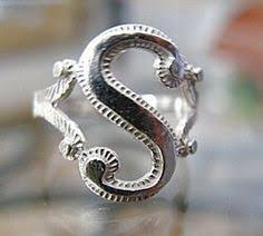 s rings 14k gold initial ring adorned with the letter s and a cherub