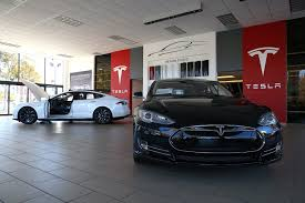 tesla dealership tesla u0027s self driving uber service could kill off taxis and car