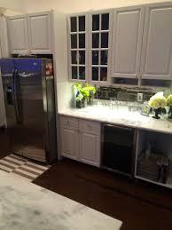 smoked mirror backsplash kitchen kitchen island marble countertop sink faucet glamorous