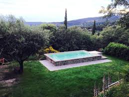 a single story house with gated security swimming pool and