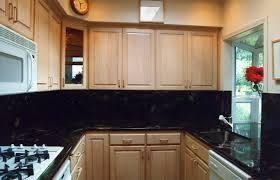 Kitchen Countertop And Backsplash Combinations by Backsplash Ideas Black Granite Countertops Maple Cabinets Bar