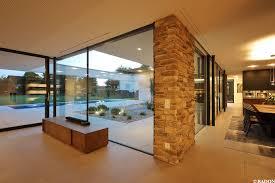 K He Fliesen Esszimmer Parkett Einfamilienhaus Pool Flachdach Steinfassade Panoramafenster