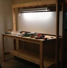 workbench with pegboard and light how to build a workbench for your garage to get organized garage