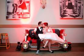 a 1950 u0027s rockabilly wedding with the coolest car couch ever