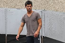 taylor lautner rocks an arm tattoo films a heist scene on the
