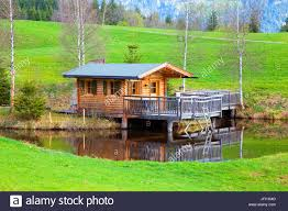 small country house in the pond log cabin hut partial building