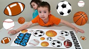 toddlers learn sport names with wall stickers