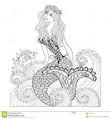 fantastic mermaid in sea waves with a goldfish and wreath stock