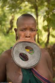 Documentary crew stumbles upon the largest lip disk in the world     Daily Mail The discs are a tradition dating back further than       and a way of attracting
