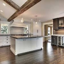 white hex tile kitchen backsplash with black grout transitional