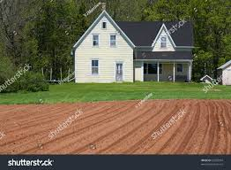 country farmhouse old country farmhouse freshly plowed field stock photo 23503504