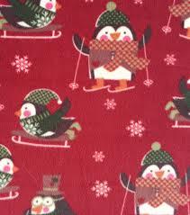 holiday inspirations christmas fabric penguins on red fleece joann