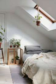 best 25 small attic bedrooms ideas on pinterest attic bedrooms attic bedroom in a charming plant filled attic apartment in sweden gravity home