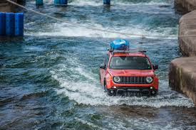 white jeep renegade jeep renegade drives through rapids carwitter