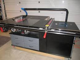 Table Saw Cabinet Plans My Sawstop And Router Cabinet With Fold Down Outfeed Table And