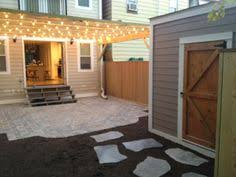 Backyard Bistro Cary Nc Columbus Screen Porch With Paver Patio And Rounded Stairs For