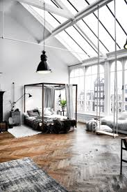 Loft Bed Hanging From Ceiling by Black Hang Lamp On The White Ceiling Of Loft Ceiling Interior