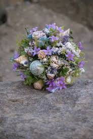 wedding bouquets with seashells blue seashell bouquet wedding destination wedding
