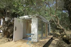 tiny prefab home is a dreamy off grid retreat on the island of