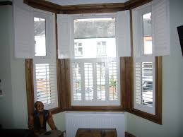 bow window shutters bow window treatments bing images home bow window shuttersbudget blinds hingham ma shutters shades blinds window