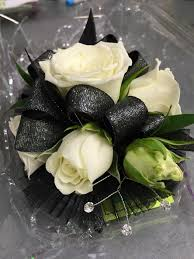 black and white corsage wristlet corsage with white spray roses black and silver ribbon