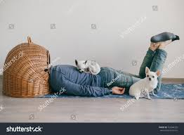 unknown male lying on yoga mat stock photo 726346225 shutterstock