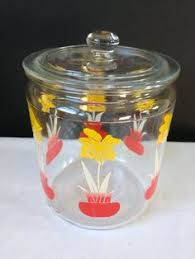 vintage glass jar with orange lid by anchor hocking roses