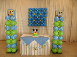 baby mickey 1st party party decorations by teresa cake table decoration i created two balloon columns in lime green light blue polka dot and yellow balloons please note the beautiful balloon wall