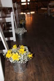wedding flowers wi daffodils baby breath gypsophila in tin buckets to decorate
