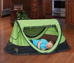 kidco peapod travel bed is easy to store