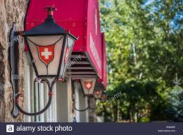 row of lanterns or ls on a building with swiss decorations in