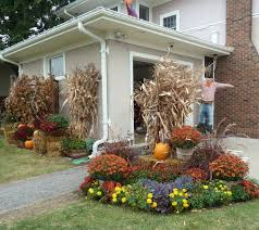 fall decorating with hay bales and mums