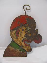 vintage carnival circus painted metal clown head signs