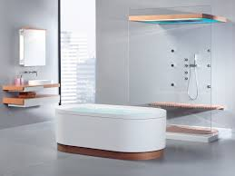 white small freestanding bathtub on grey tile floor added by glass