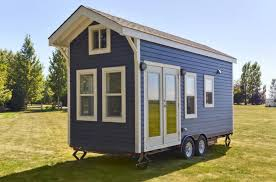 tiny homes on wheels it looks like a normal tiny house but one step inside i want to
